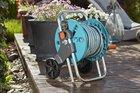 Тележка для шланга AquaRoll S со шлангом Classic 20 м (13 мм (1/2)) и комплектом для полива Gardena (18502-20, 02692-20)